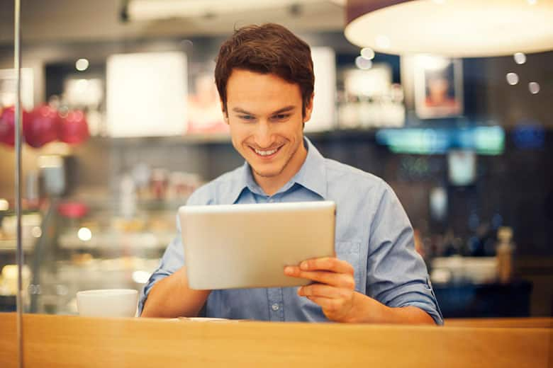 Man looking at iPad tablet