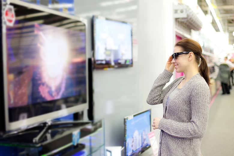 Woman shopping for 3D TV