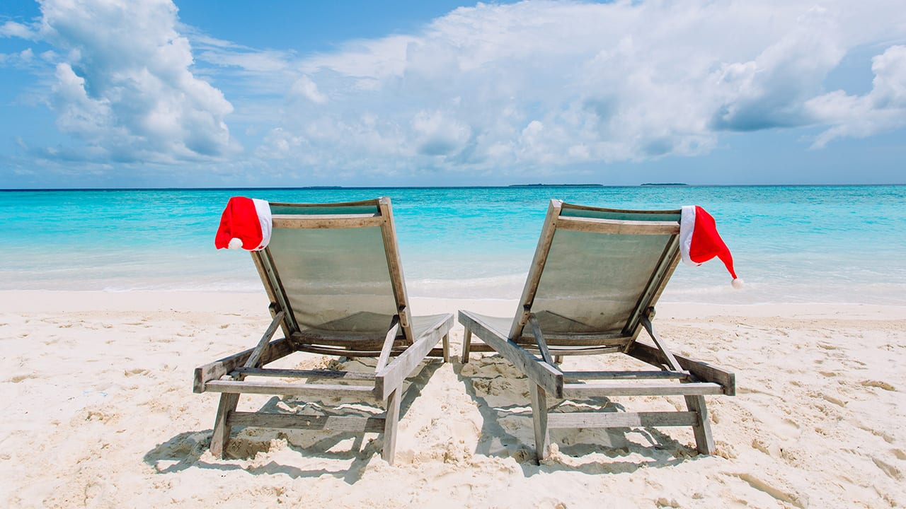 santa claus hats rest on beach chairs