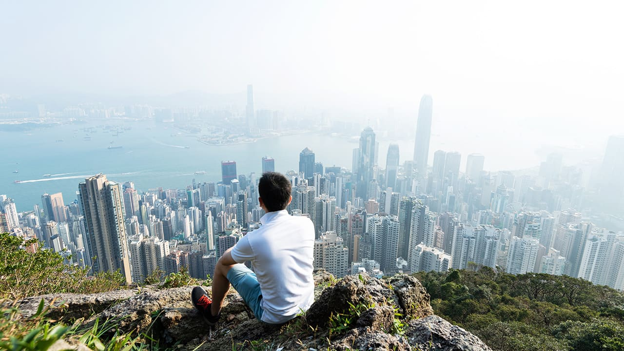 traveler looks at an asian cityscape