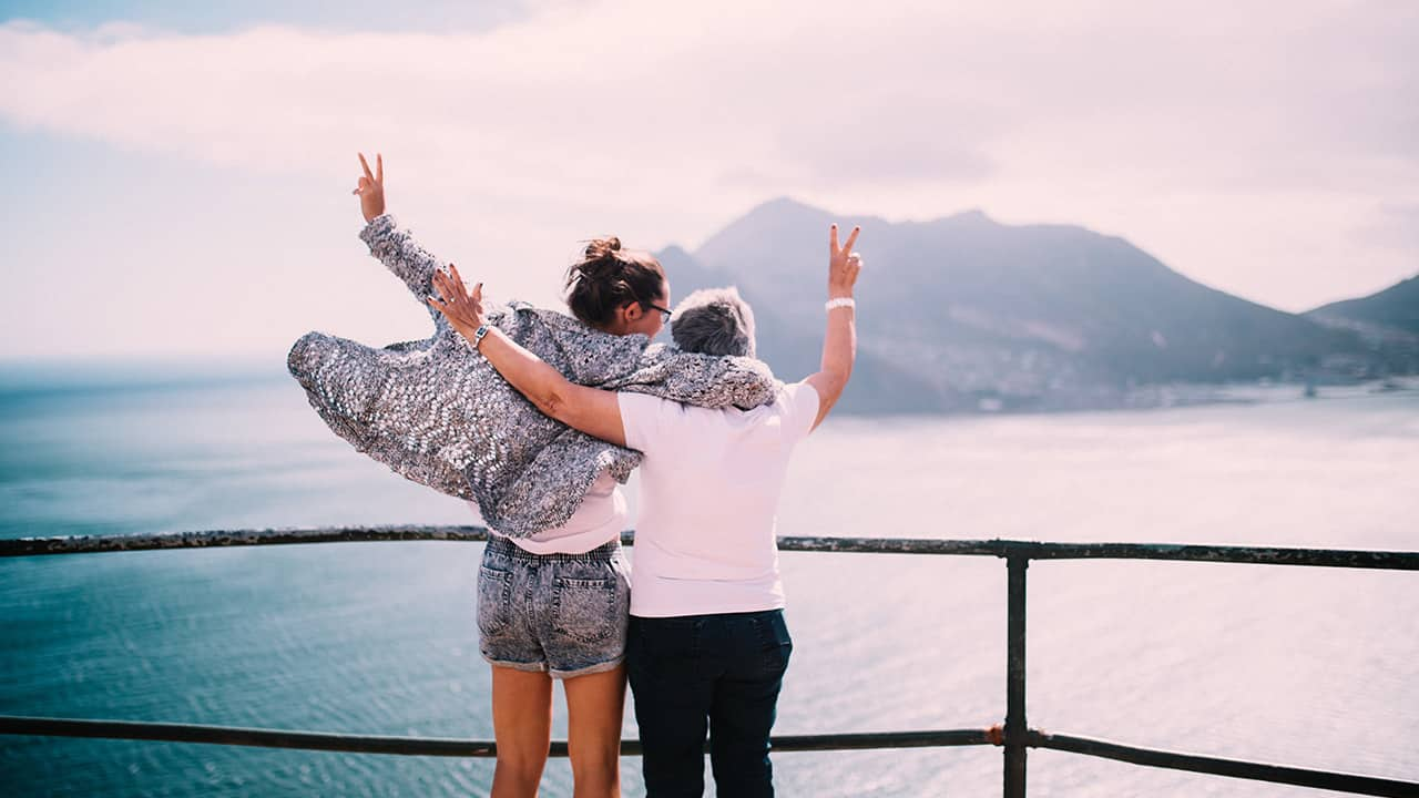 mother and daughter celebrate on a ferry
