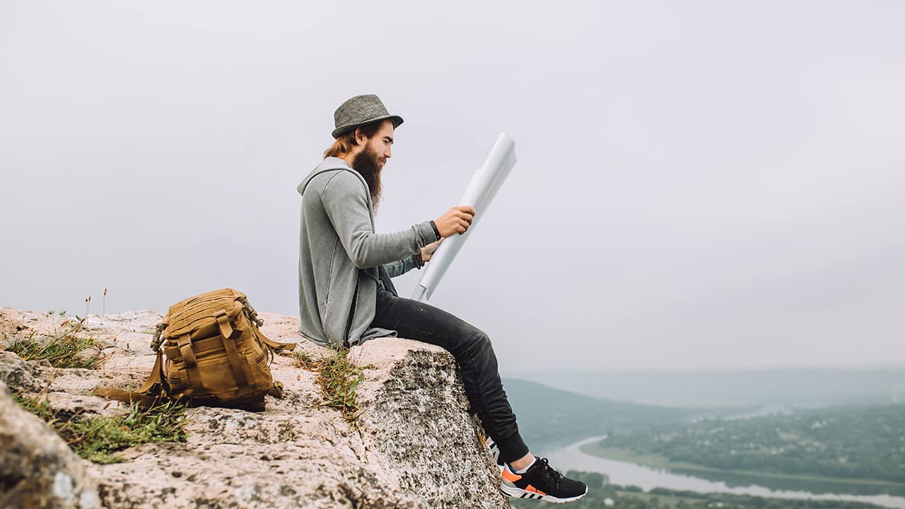 man reads from an overlook