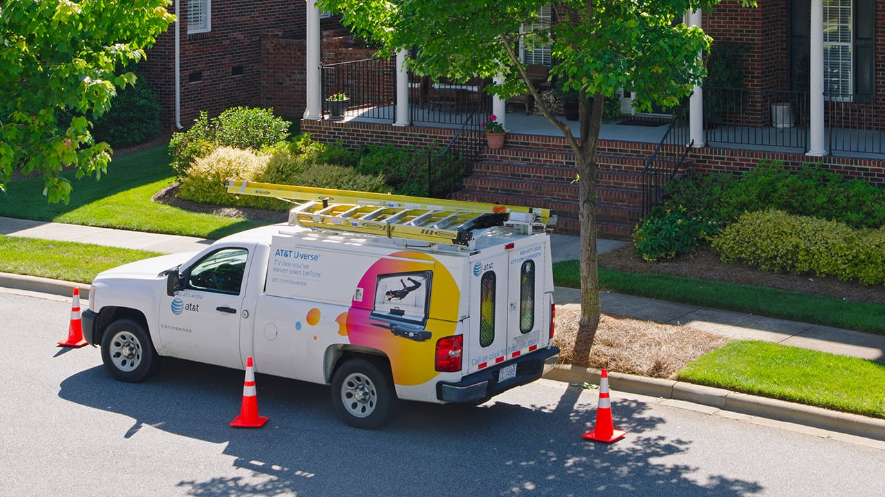 cable provider van in front of a house