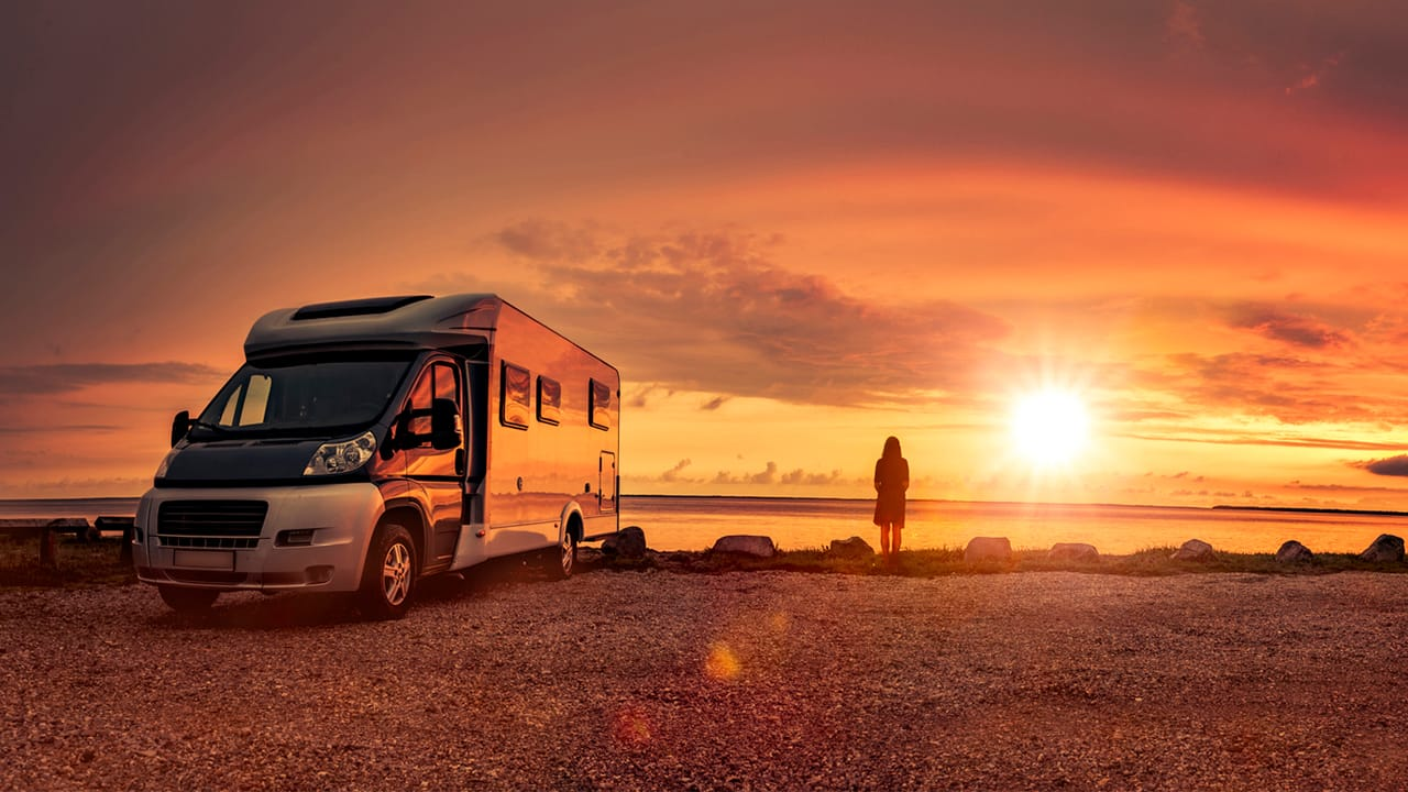 woman-with-rv-on-beach-sunset