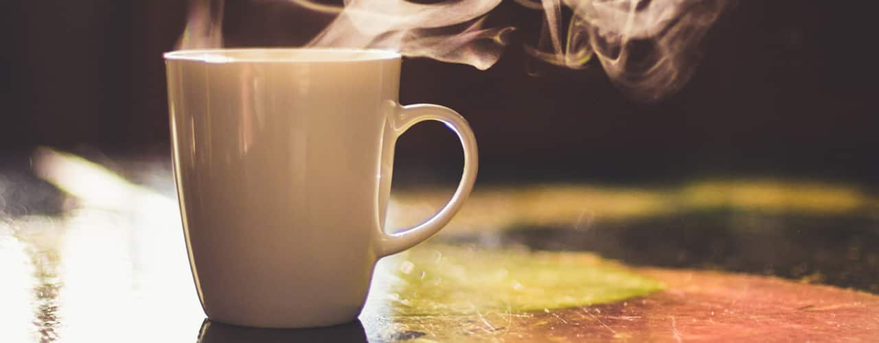steaming-coffee-in-sunlight-on-table